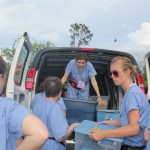 Unloading the van – this time at our first night camp, where we met the farm workers for the first time.