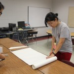Pharmacy students prepare to make signs for the different screening stations.