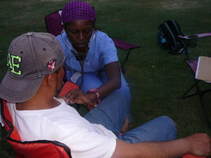 Nurse practitioner attending to a farmworker