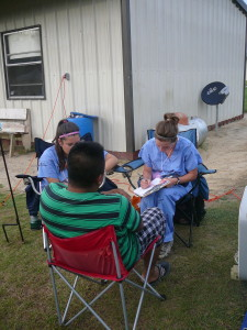 Nurse practitioners working with a farmworker