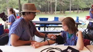Tyler testing out the blood pressure cuffs before farmworkers arrive.