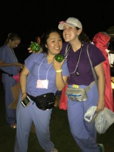 Jennifer and Lucy pose with free bell peppers courtesy of the farm workers