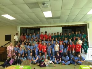 The interdisciplinary team (Emory BSN & NP students in blue scrubs, UGA Pharmacy in red, and Clayton State Dental Hygiene in green scrubs)